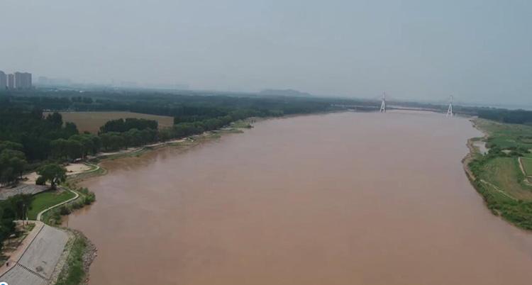 航拍黄河洪峰过境济南 比上次小浪底调水调沙流量小、过程短